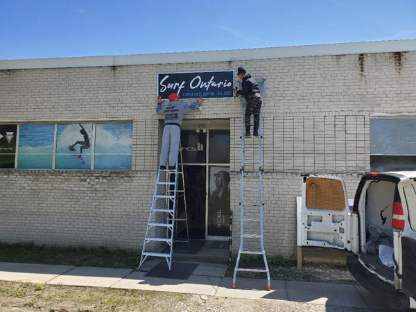 The Surf Ontario shop sign going up in the spring.