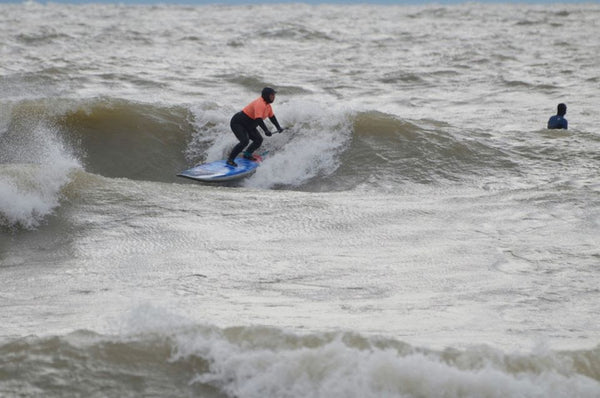 Robin Pacquing loving the lefts at The Wyldewood Gales on Lake Erie. Photo by Geoff Ortiz.