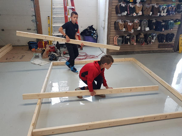 Youngsters learning how to frame for our re-purposed skid wall.