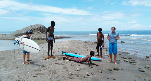 Mike teaching kids surfing in the Caribbean.