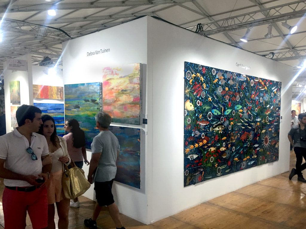 an image of mixed media on canvas and a large-scale installation work.