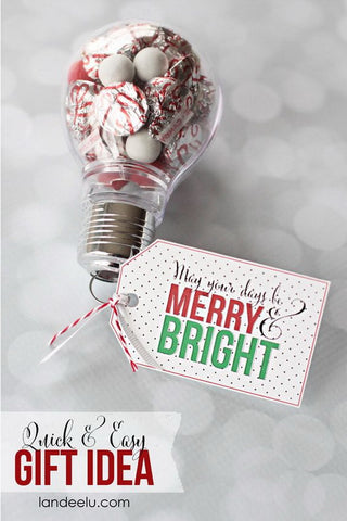 Plastic light bulb filled with chocolate kisses and a tag made using cardstock and printed with the words May your days be Merry & Bright