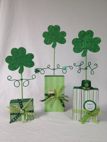 St. Patrick's Day decorations made with 2 x 4 blocks of wood.
