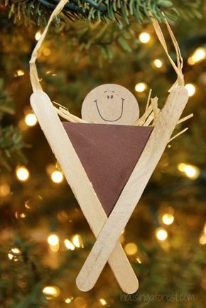 Baby Jesus in creche Christmas ornament made with Popsicle sticks and cardstock