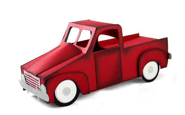 red pickup truck made of paper