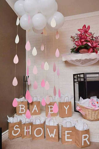 Baby shower balloon and cardstock raindrops decorations
