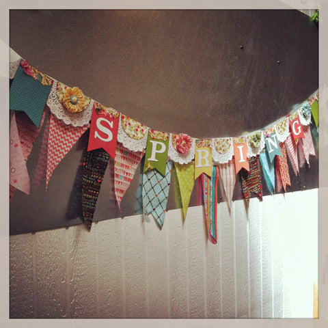 """Spring"" paper banner with pattern paper and doilies, fabric and ribbon"