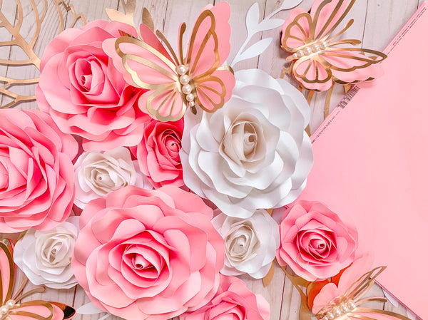 paper butterflies on a bed of pink paper roses