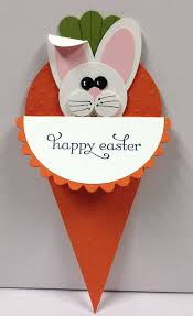 Easter bunny tucked into a paper carrot card.