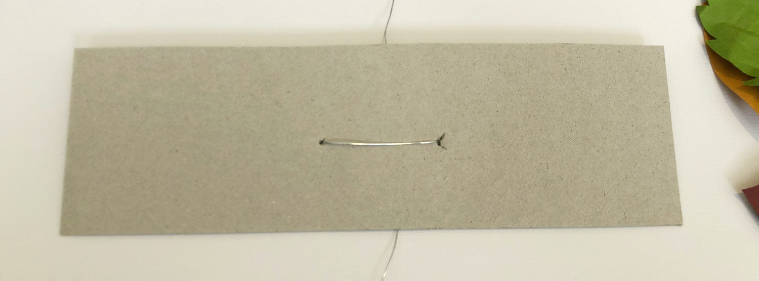 chipboard rectangle base with wire in it