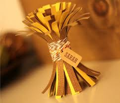 Paper cornstalks made into a place card for fall parties