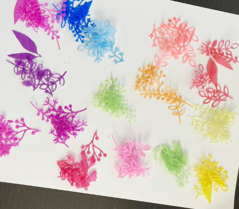 rainbow colored vellum flowers and leaves