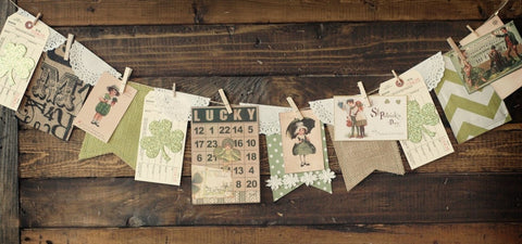 St. Patrick's Day paper banner with misc. leprechaun's and misc. green papers and shamrocks.