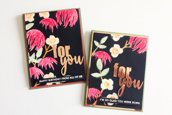 two handmade cards using white embossing powder and copic markers