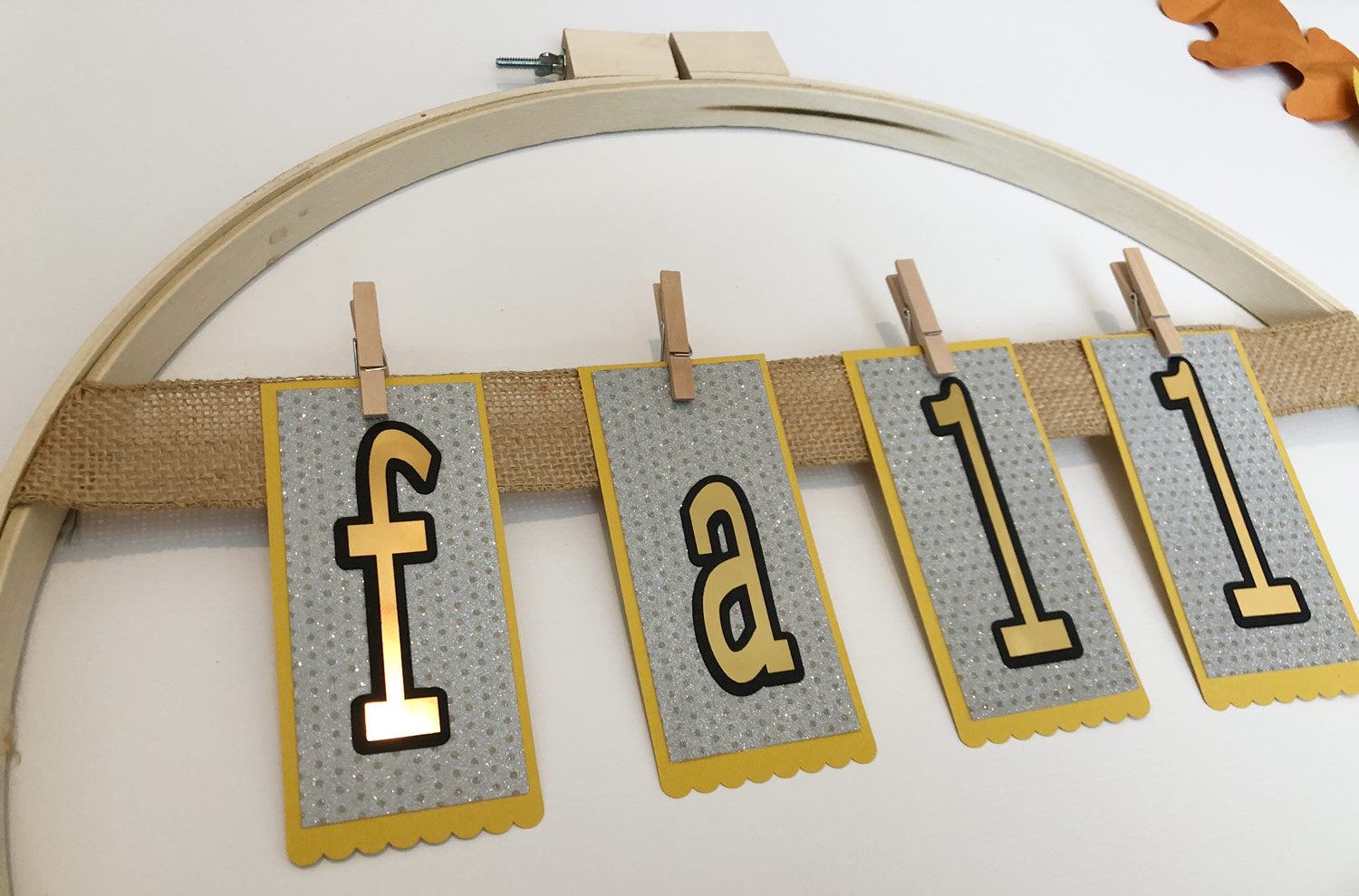 fall paper banner attached to burlap ribbon