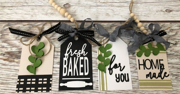 set of four farmhouse style paper tags