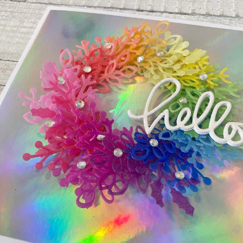 rainbow vellum wreath on a holographic background