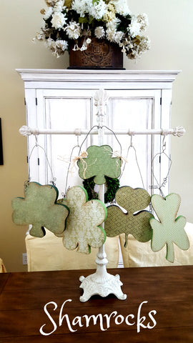St. Patrick's Day shamrocks made from wood painted and decorated with pattern paper.