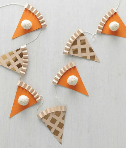 Pumpkin and apple pie paper garland hanging on a string