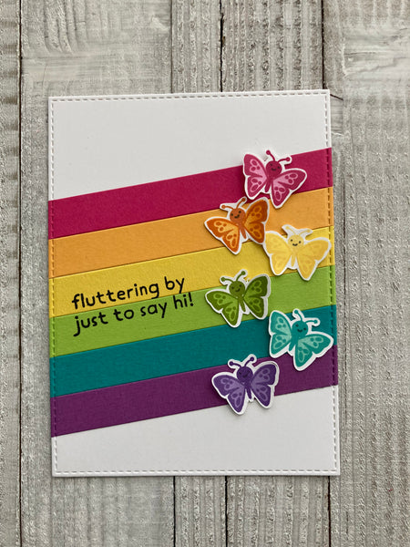 rainbow strips on a white background with butterfly stamps