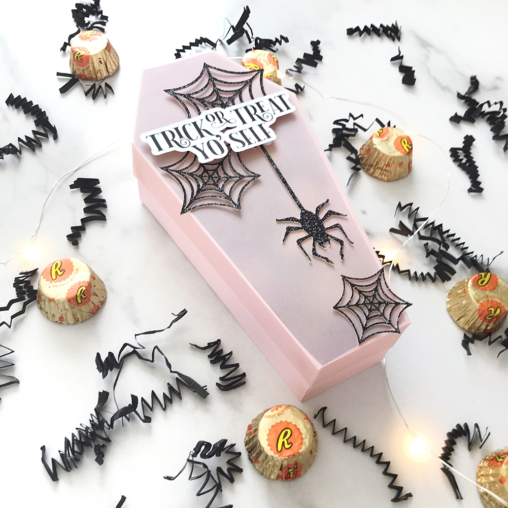 vellum halloween tomb treat container with candy spread around