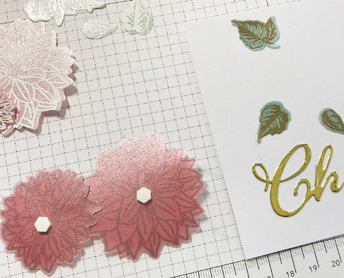 attaching colored vellum flowers
