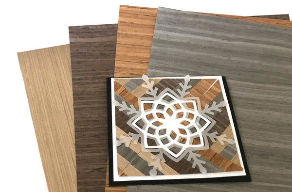 wood grain papers fanned out with a handmade card on top