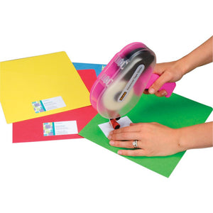Woman using Scotch Advanced Tape Glider on cardstock