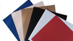 Fan array of six colors of 12x12 corrugated specialty paper from DCWV