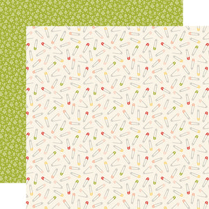 12x12 patterned cardstock with multi-colored safety pins on ivory background and petite white floral design on green reverse