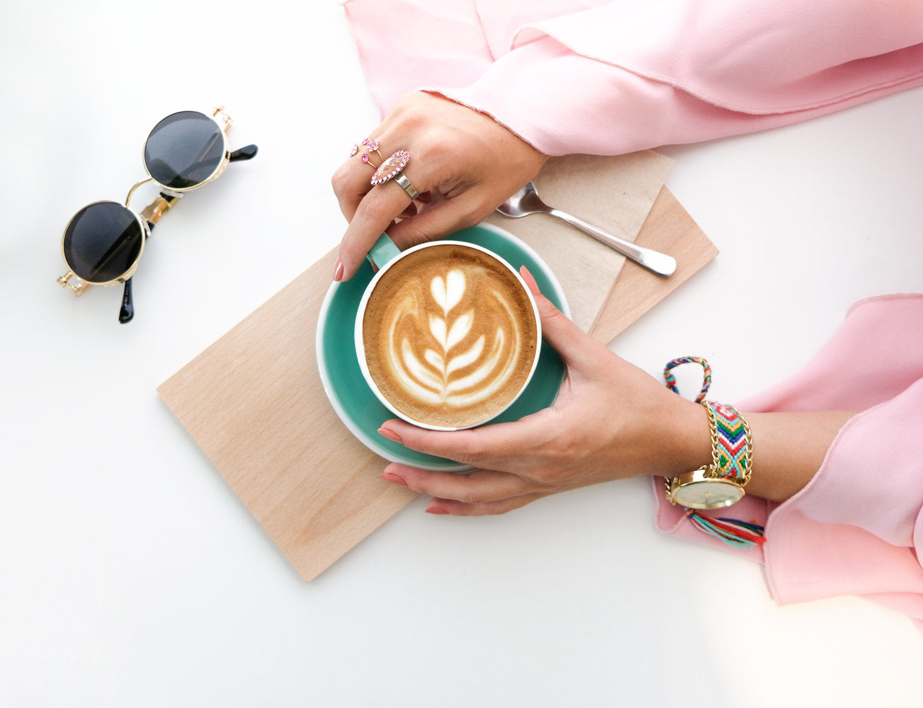 lady in pink holding a cup of coffee