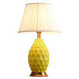 Textured Ceramic Oval Table Lamp with Gold Metal Base Yellow