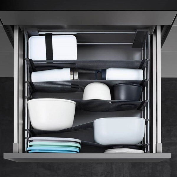 Spaceflexx Drawer Organisation installed in kitchen drawer to organise tupperware