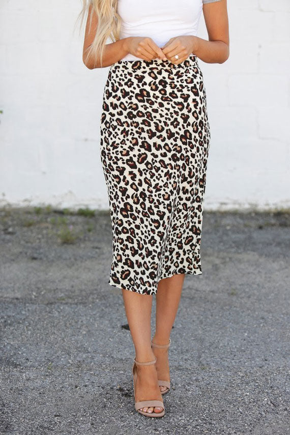 a fitted pencil skirt with a leopard print