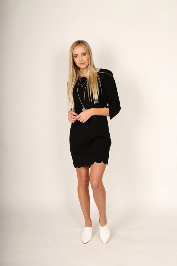 a woman modeling a little black dress