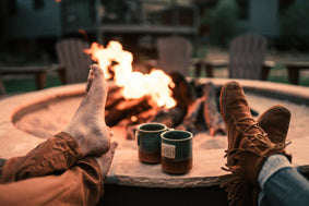 Couple Wearing Moccasins and Barefoot by Fire Pit