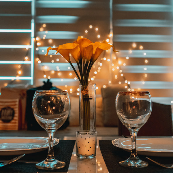 orange flowers and sparkling place settings for a dinner date night