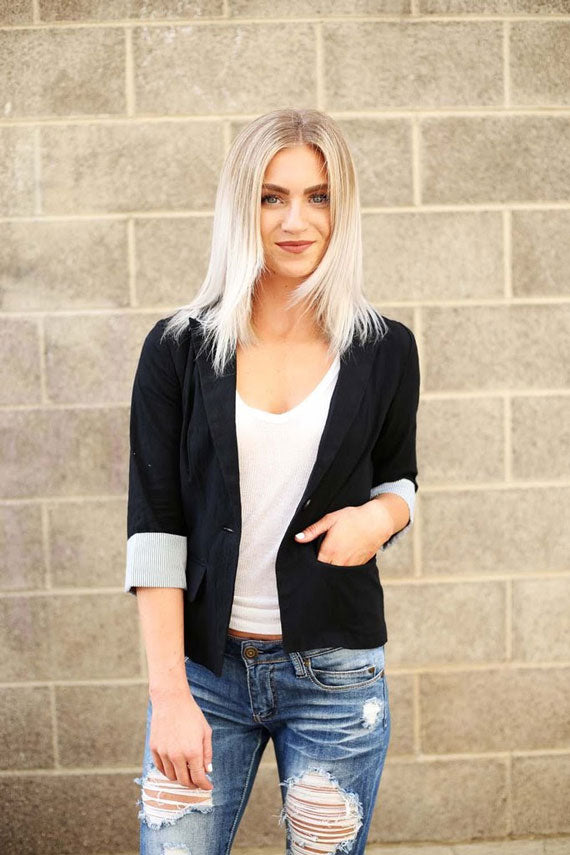 a woman in a stylish black blazer