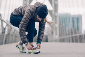 Female Runner Lacing Up Her Shoes