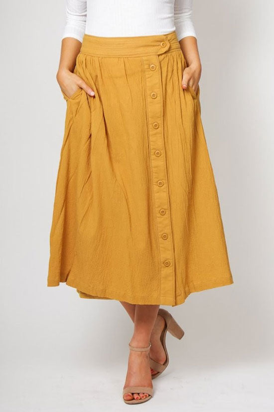 a mustard yellow midi skirt