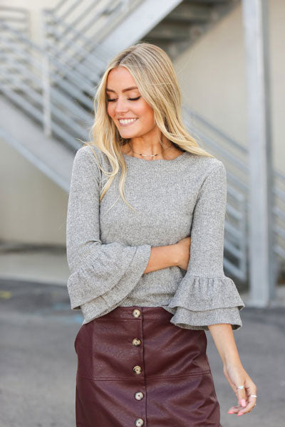 focus on a structured gray sweater