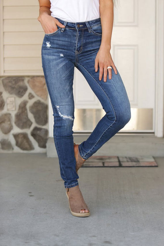 a pair of distressed, high waist jeans