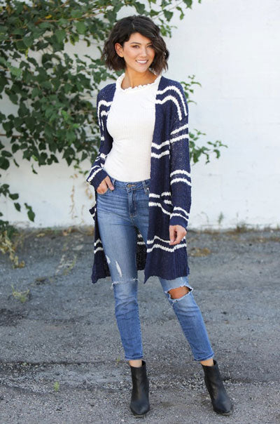 a blue and white striped cardigan