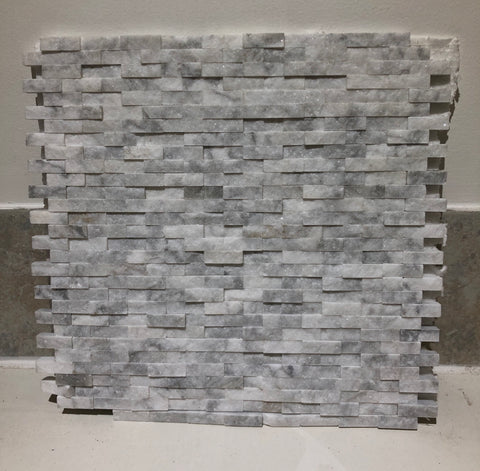Carara natural splitface stone on sheets per each