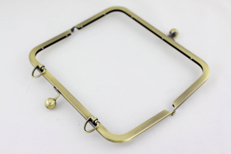 8 3/4 x 4 inch - Antique Brass Kisslock Clutch Frame with D Ring Chain Loops | SUPPLY4BAG