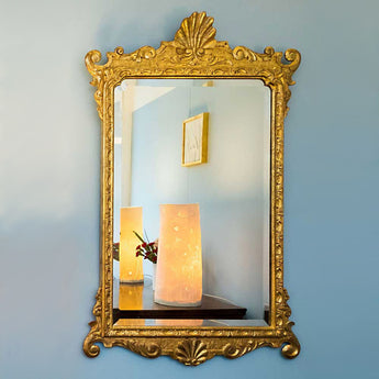 Carved and gilt mirror