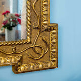 Carved and gilt serpent mirror