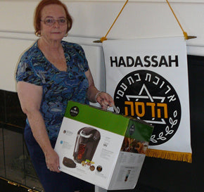 CoffeeForLess donated a B-40 Keurig machine to Hadassah Women's Volunteer Organization, April 2011.