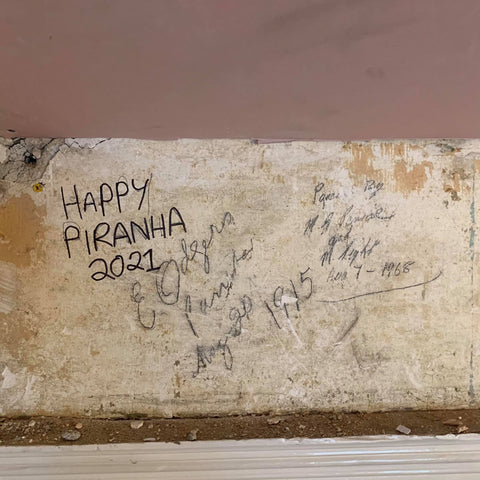 Notes left on a wall at the Happy Piranha building project from 1915 to 2021