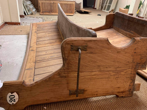 Some reclaimed church pews that will be converted into booths for the café